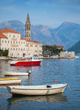 Landscape with boats. Old Perast town Royalty Free Stock Photo