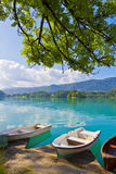 Landscape with boats at the pier of Bled Lake, Slovenia stock image