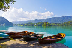 Landscape with boats at the pier of Bled Lake, Slovenia stock photo