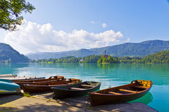 Landscape with boats at the pier of Bled Lake, Slovenia royalty free stock photography