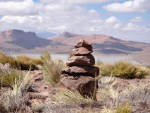 Landscape Bolivia wishing stone tower at high altitude Stock Images