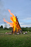 Landscape with bonfire Stock Photos