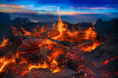 Landscape with bonfire, night and bright hot flame Royalty Free Stock Photo