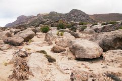 Landscape with boulders, weathered stones, sandstones, rocks and mountains Stock Photography