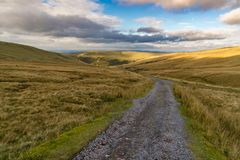 Walk towards Llyn y Fan Fach, Wales, UK. Landscape in the Brecon Beacons National Park on the way to Llyn y Fan Fach in Carmarthenshire, Dyfed, Wales, UK Royalty Free Stock Image