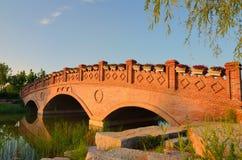 Landscape with brick arch bridg Stock Images