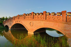 Landscape with brick arch bridg Stock Photos