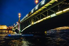 Landscape with bridge at night, view from Neva river in St. Petersburg Stock Photography