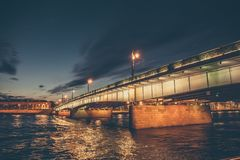 Landscape with bridge at night, view from Neva river in St. Petersburg Stock Photos