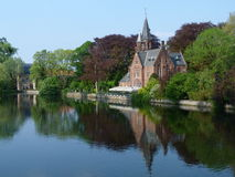 Landscape in Brugge, Belgium. Landscape with a church in Brugge, Belgium Stock Images
