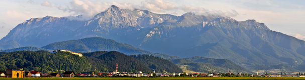 Landscape with bucegi mountain. Panorama landscape with bucegi mountain and rasnov village in transylvania, romania Royalty Free Stock Photography