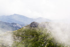 Landscape from Bucegi Mountains, part of Southern Carpathians in Romania in a foggy day Royalty Free Stock Photography