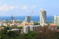 Landscape of buildings with sea and blue sky and cloud, Pattaya Thailand. Landscape of buildings with sea and blue sky and cloud, Pattaya Thailand, as nature Stock Image