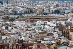 Landscape with bull ring in Sevilla, Spain. Landscape of Sevilla, typical city of Andalucia, Spain. We can see the bull ring (Plaza de Toros) home of royalty free stock photography