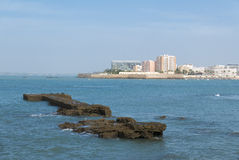 Landscape of Cadiz waterfront and town from the beach. Spain Royalty Free Stock Photos
