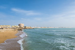 Landscape of Cadiz waterfront and town from the beach. Spain Royalty Free Stock Images