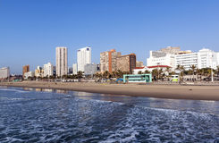 Landscape of Calm Ocean Empty Beach  Against City Skyline Royalty Free Stock Photos