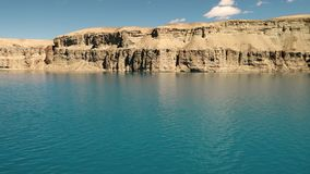 Landscape of calm, tranquil blue lake with waves. Surrounded by travertine mountains. Band-e Amir Lakes. Band-e Amir National Park, Bamyan Province, Afghanistan stock video footage