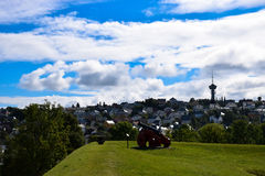 A landscape with cannon in Trondheim, Norway. A cannon in Trondheim, in Norway, with a beautiful view of the city, sky and clouds Royalty Free Stock Photo