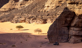 Landscape of the canyon of Tadrart in the Algerian desert. This is the canyon of Tadrart in the algerian desert of Tassili N`Ajjer. the Car in parked in the Stock Image