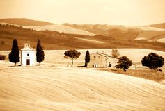 Landscape with the Capella di Vitaleta in tuscany. Cultivated land farm tuscany hill, meadow Stock Image