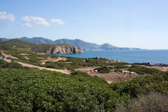 Landscape in Capo Pecora, Sardinia, Italy. The view on the sea and mountains in summer in Capo Pecora, Sardinia, Italy Royalty Free Stock Photography