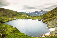 Landscape from Capra Lake and Fagaras mountains Stock Photos
