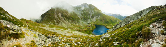 Landscape from Capra Lake in Romania. And Fagaras mountains in the summer Royalty Free Stock Images