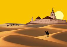 Landscape - caravan in the desert goes to the old fortress. Stock Image