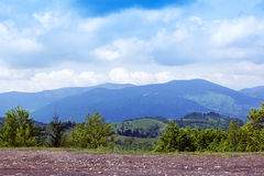 Landscape of a Carpathians mountains with green trees and brown Royalty Free Stock Photo