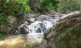 Landscape of cascade and water stream with the sunbeam in s Stock Photography