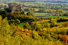 Landscape with castle. A big castle overlooking a rolling rural landscape royalty free stock photos