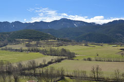 Landscape of the Catalan Pyrenees, Cerdanya, Girona, Spain. Beautiful landscape of the snowy mountains and green valley in the Catalan Pyrenees. Image taken in stock photos