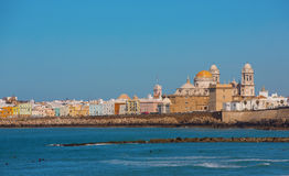 Cadiz and ocean. Landscape of the Cathedral of Cadiz and old town from the beach Stock Images
