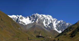 Landscape with Caucasus Shkhara mountain seen from Ushguli villa Royalty Free Stock Images