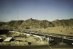 Landscape of Cave of Bani Haram. Medina, Saudi Arabia - December 15, 2016 ; Landscape surrounding cave of Bani Haram, road, cars, street lighting and others Stock Photography