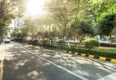The landscape in the center of city, modern commercial background. A sunny day street road urban office business architecture building asphalt construction stock images