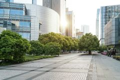 The landscape in the center of city, modern commercial background. A sunny day street road urban office business architecture building asphalt construction stock photography