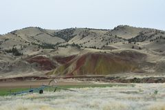 Landscape of Oregon`s Painted Hills Nat`l Monument. This is a landscape of Central Oregon`s Painted Hills Nat`l Monument. Irrigation equipment is located on a stock photos