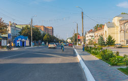 Landscape with central street  of the small city at autumnal weekend Stock Photo