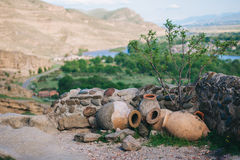 Landscape with ceramic amphora for wine on a background of mountains outdoors . Landscape with ceramic amphora for wine on a background of mountains outdoors stock photo