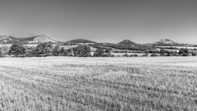 Landscape of Ceske Stredohori, aka Central Bohemian Highlands, with typical spiky hills of volcanic origin, Czech. Republic. Black and white image stock photos