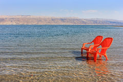 Landscape with chairs at the Dead Sea Royalty Free Stock Photos