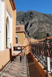 Landscape of Chefchaouen, Morocco. Terrace with chairs and in the background the mountain Royalty Free Stock Photo
