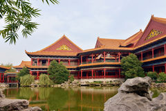 Landscape of Chinese ancient garden. Chinese ancient garden .Oriental scenery park with courtyard trees,flower, pavilion,wooden corridor & lake.Asia rockery Royalty Free Stock Images