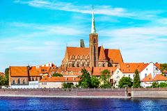 Landscape of the church above the river, the old town of Wroclaw, Poland, the ancient church, the architecture of the city royalty free stock photography