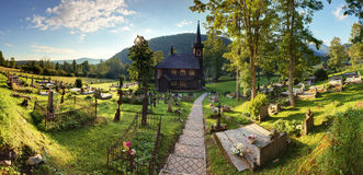 Landscape with church and cemetery in Slovakia, Tatranska Javori Royalty Free Stock Photos
