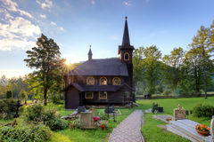 Landscape with church and cemetery in Slovakia, Tatranska Javori Stock Photo