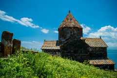 Landscape with church, Khachkars and grass stock images