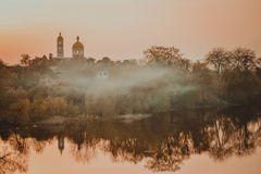 Landscape church river fog Stock Photography